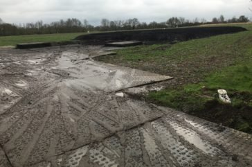 Agricultural supplies tipping on farm land with trakway